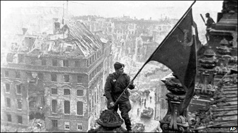 Soviet soldiers hoisting the red flag over the Reichstag in Berlin, 1945