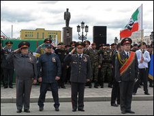 Ramzan Kadyrov (in forage cap) reviews troops in Grozny on 9 May