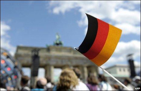 German flag in front of the Brandenburg gate