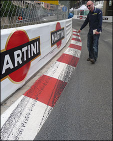 BBC Sport's Andrew Benson points to the tyre marks near the barrier