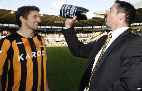 Wales defender Sam Ricketts celebrates Premier League survival with Hull manager Phil Brown