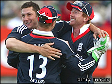 Paul Collingwood, Tim Bresnan and Matt Prior celebrate an England wicket
