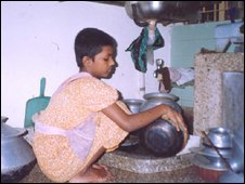 young girl working in kitchen