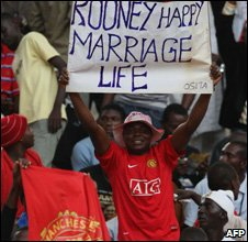 Fans watch a pre-season friendly between Manchester United and Portsmouth in Abuja, Nigeria, on 27 July 2008