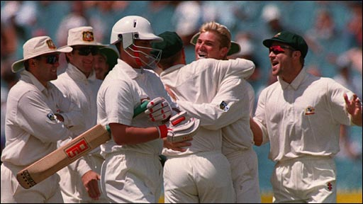 Shane Warne celebrates another victim