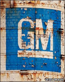Paint peels from the GM logo painted on a chimney at a shuttered GM assembly plant, Wisconsin