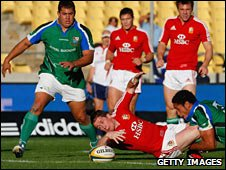 Shane Williams drops the ball as he crosses the line against Royal XV