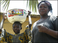 "Modestine Danbe and daughter with a bowl of the fried blood dish known as ""Vampire"""