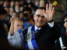 Maurico Funes with his son after the swearing-in