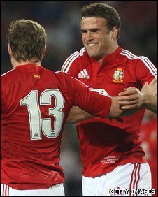 Brian O'Driscoll and Jamie Roberts congratulate each other after a try