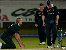 Stuart Broad (left) is dejected after England's defeat