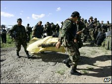 Peruvian police carry away the body of a comrade killed near Bagua on 5 June