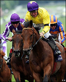 Kinane and Sea The Stars (centre) ease to victory ahead of Fame And Glory and Masterofthehorse