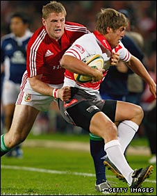 Jamie Heaslip puts in a tackle against the Golden Lions