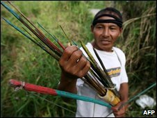 An indigenous man holds arrows in Yurimaguas, 09/06