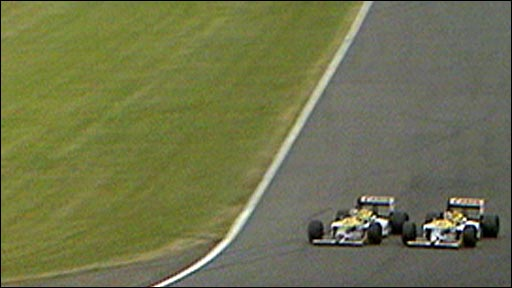 Nigel Mansell sails past Nelson Piquet