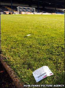 A ticket stub for Ninian Park's final game lays on the pitch