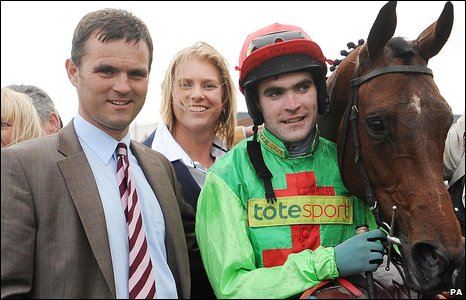 Trainer Evan Williams, jockey Donal Fahy and Plunkett enjoy a Ffos Las first