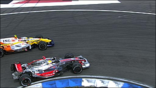 Lewis Hamilton gets past Nelson Piquet
