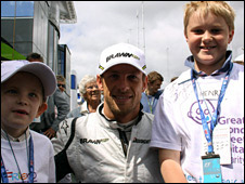 Jenson Button with two Great Ormond Street patients