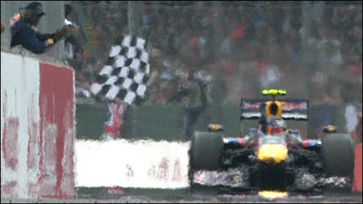 Red Bull's Sebastian Vettel takes the chequered flag at Silverstone