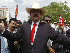 President Manuel Zelaya leads supporters though the Honduran capital on 25 June 2009