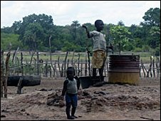 Children at a well in Guinea Bissau