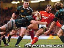 Schalk Burger chops down Wales' Gavin Henson