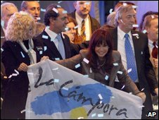 President Cristina Fernandez holds a flag during a closing campaign rally in Buenos Aires, Thursday