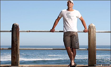 Mitchell Johnson poses at the beawch in Cape Town