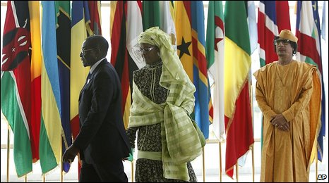 Col Gaddafi, right, greets Zimbabwe President Robert Mugabe and first lady Grace Mugabe