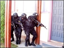 Bosnian national police storming a building
