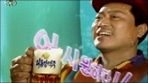 Miner drinking beer