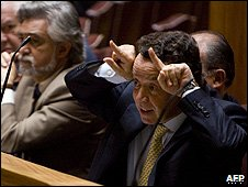 Manuel Pinho makes a gesture, like he has horns, towards an opposition MP