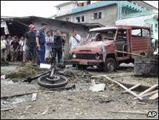 Police examine the site where a bomb apparently hidden on a motorcycle exploded Tuesday July 7, 2009 in the volatile southern Philippine island of Jolo