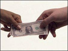 Man holding Nigerian banknotes