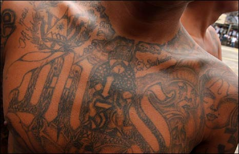 Gang members sport elaborate tattoos as a sign of their allegiance