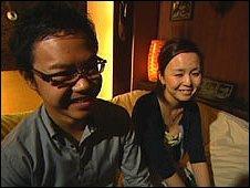 Yuichi Ito and Kyoko Shio in a hotel room