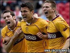 John Sutton (centre) celebrates Motherwell's first goal at Llanelli