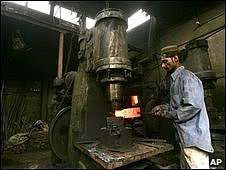 A worker with a furnace in a Karachi factory, 29 June