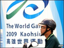 Motorbike man in front of Taiwan World Games banner, 15 July 2009