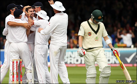 Michael Clarke makes his way back to the pavilion as England celebrate