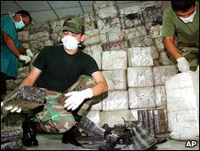 Venezuelan drug officials open bags of cocaine (file image)