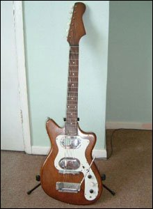 Phil's first electric guitar was a Broadway which cost just under £20