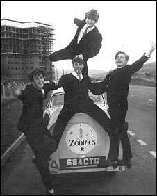 Concrete and clay - the Zodiacs strike a wacky pose in front of the Hirwaun flats under construction