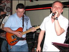 Phil keeps his hand in playing in a Bangkok bar with friend Lee Edwards in February 2008
