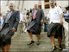 Former prime minister Laisene Qarase, centre, leaving church, Suva, Fiji, 3 Dec 06