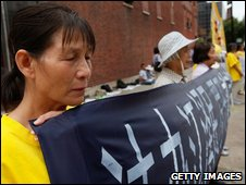 Falun Gong practitioners demonstrate in front of the Chinese Consulate July 20, 2009 in Chicago