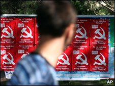 Moldovan glances at Communist Party posters