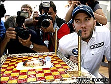 Nick Heidfeld with a cake